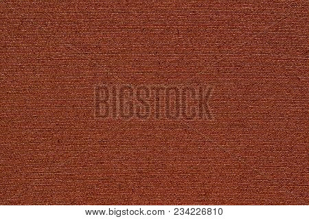 Abstract Macro Texture Of Damp Synthetic Fabric For A Background Of Red Color