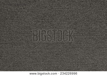 Abstract Macro Texture Of Damp Synthetic Fabric For A Background Of Dark Beige Color