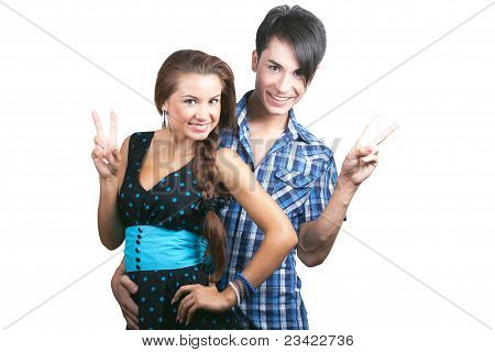 A Young Happy Couple Showing Thumbs Up.