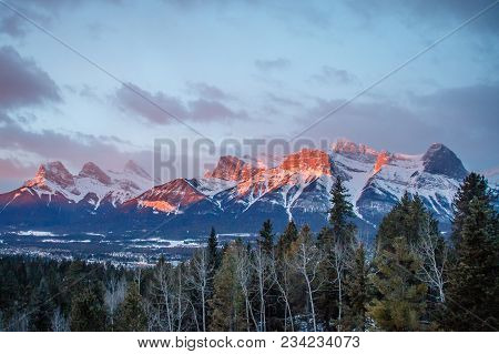 Panoramatic View Of Mountain Range Above Town Of Canmore In Canada, Sunrise View Of Canadian Rockies