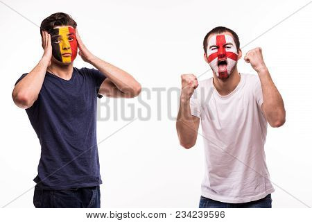Happy Football Fan Of England Celebrate Win Over Upset Football Fan Of Belgium With Painted Face Iso