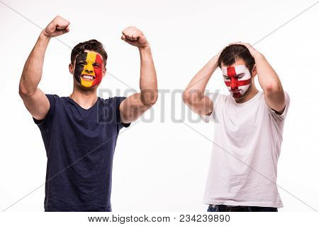 Happy Football Fan Of Belgium Celebrate Win Over Upset Football Fan Of England With Painted Face Iso
