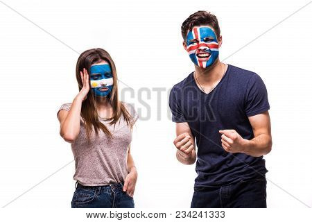 Happy Football Fan Of Iceland Celebrate Win Over Upset Football Fan Of Argentina With Painted Face I
