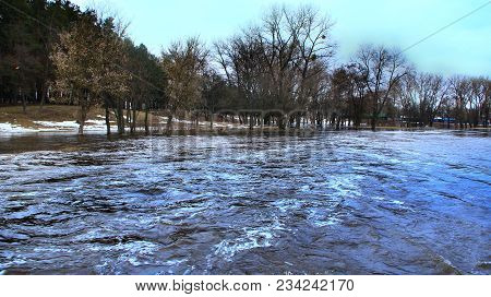 Flooding Of River In Spring In Town During Melting Of Snow. Flooding City. Flood Between Private Hou