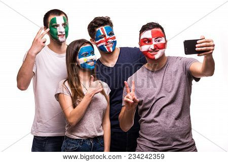 Group Of Fans Suport Their National Teams With Painted Faces. Argentina, Croatia, Iceland, Nigeria F