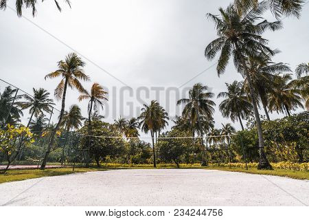 Wide-angle Frontal View From The Bottom Of The Volleyball Court: Coral Sand On The Ground, Multiple