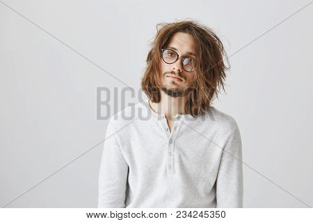 Tired Messy Guy Had No Sleep At Night. Portrait Of Nerdy Attractive Male In Glasses, Standing Indiff