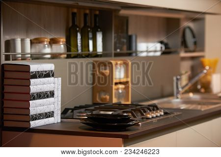 New Modern Kitchen Interior With Books And Various Kitchen Utensils On The Table. Luxury Kitchen Wit