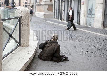 Rome, Italy - November 18, 2017 , Elder Woman Homeless In The Street