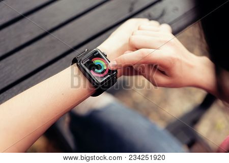 Bangkok, Thailand - April 03, 2018 : Woman Touch Screen On Checking Activity App On Apple Watch, Cre