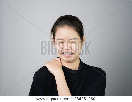 Asian Girl In Black Casual Dress Catch That Shoulder, Because Of The Pain Of Hard Work. Or Something