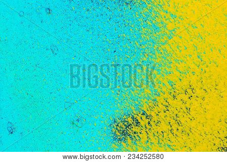 Old Metal Blue Surface With Yellow Paint. Abstract Background, Texture
