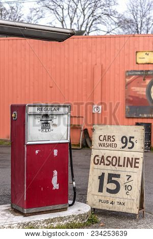Old Auto Gas Station, Advertising For Cheap Gasoline, Rusty Metal Barrels, On A Summer Day