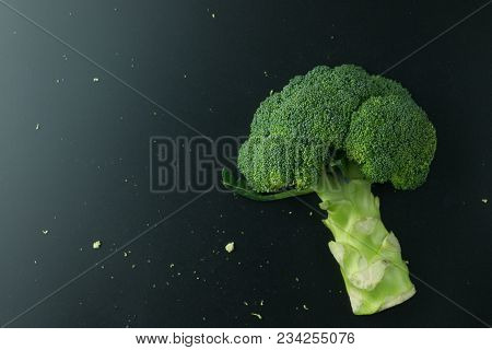 Fresh Broccoli On Black Background. Top View