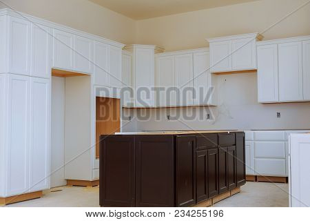 Installing New Induction Hob In Modern Installation Of Kitchen Cabinet Beautiful White Kitchen