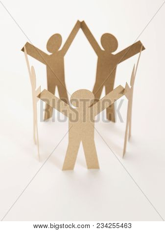 Close Up Of Closed Joining Of Five Brown Paper Figure In Hand Up Posture On White Background. In Con
