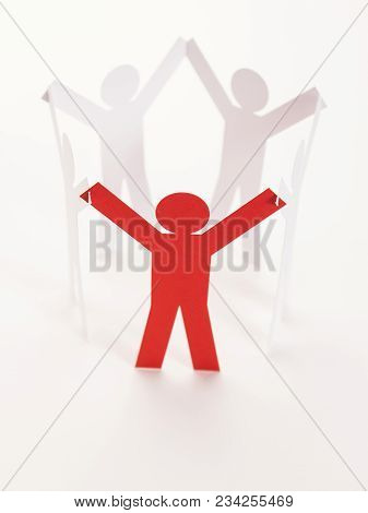 Close Up Of Red One In Closed Joining Of Five Paper Figure In Hand Up Posture On White Background. I