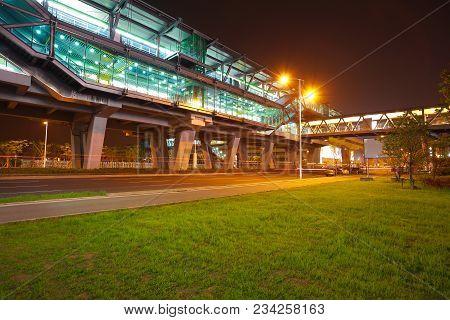 Empty Green Grass With Viaduct Bridge Of Night
