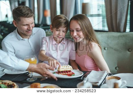 Young family with a child dining in a restaurant
