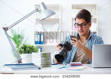 Young photographer working with his camera
