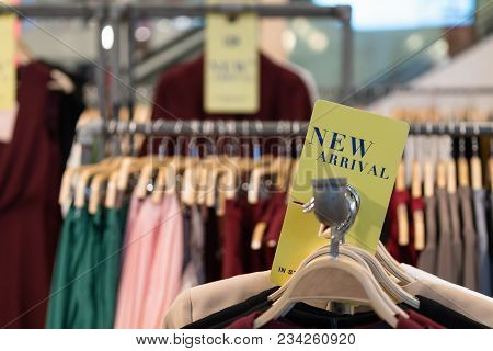 Clothes/shirt On Wooden Hanger With New Arrival Fashion Tag/sign Available In Store. Latest Cotton S