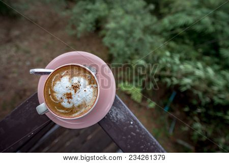 Coffee Latte In White Cup On Plate Stay On Porch With Mountain View, Traveling In Thailand