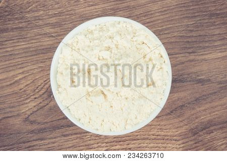 Vintage Photo, Heap Of Millet Flour In White Glass Bowl On Board, Concept Of Healthy And Gluten Free