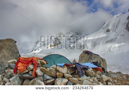 Stunning Mountain Scenery With A Tent. Climbing Tent Camp, Set At High Altitude Near The Glacier. Eq