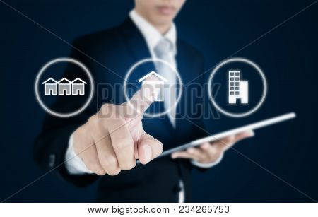 Businessman Pressing Real Estate Icons On Screen. Business Investment In Real Estate, Town House, Si
