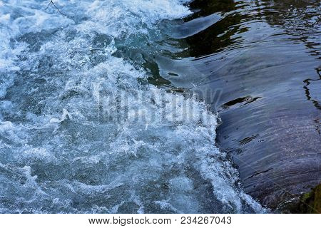 A Close Up Photograph Of A Small Waterfall Made From Stone Wall, Small Waterfall. The Height Differe