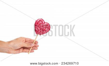 Hand Made Candy Heart Shape In Hand Isolated On White Background. Copy Space, Template.