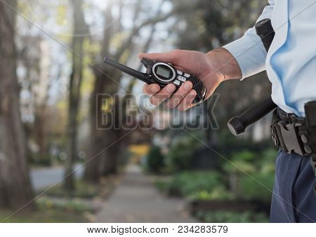 Security man outside on path of trees