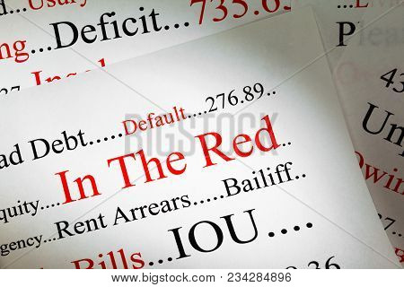 Debt Concept - N The Red - A Conceptual Look At Being In Debt.