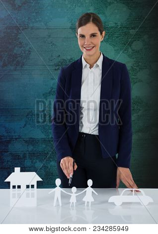 Cut outs of insurance with woman on grunge background