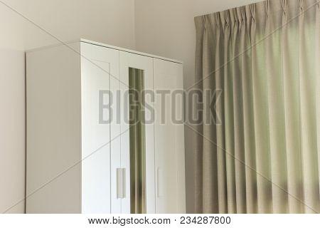 Modern White Wooden Wardrobe In The Room