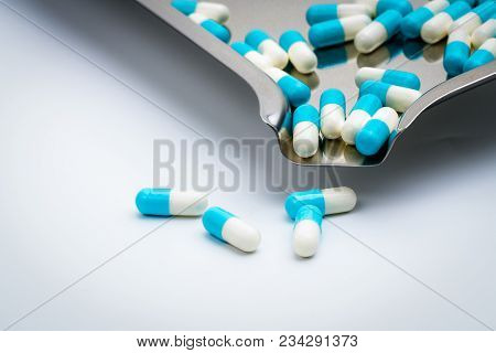 Blue And White Capsules Pills And Drug Tray On White Background With Copy Space For Text. Global Hea