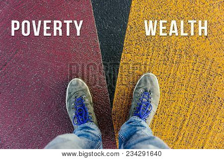 Divide Between Rich And Poor Symbolized By Two Feet Standing On Two Different Colors On Pathway From