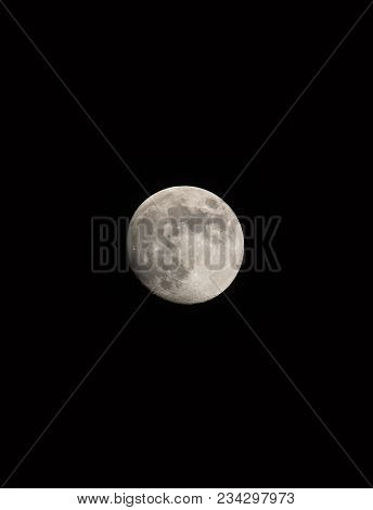 Waxing Gibbous Moon, Portrait Orientated Image With Moon Isolated On Black Background With Text Or C