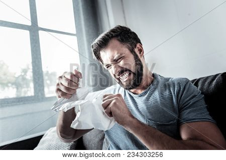 Overwhelmed My Emotions. Hysteric Angry Emotional Man Holding A Sheet Of Paper And Tearing It Up Whi