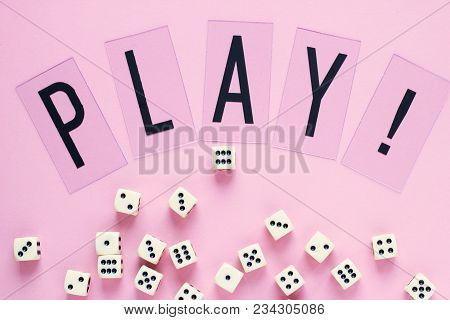 Gaming Dice With Word Play On Pink Background. Concept For Games, Game Board, Presentation, Banners