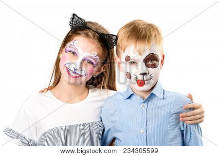 Happy children with face paintings on white background