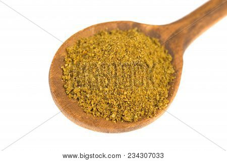 Curry Powder  On Wooden Spoon  Isolated On White Background