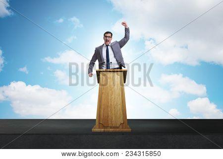 Man businessman making speech at rostrum in business concept