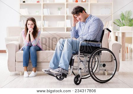 Desperate disabled person on wheelchair