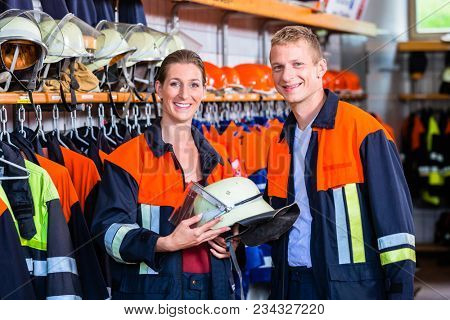 Male and female fire fighters before next alert