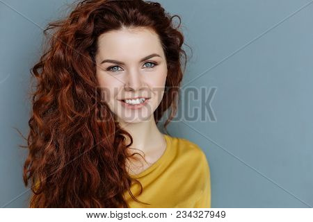 Beautiful Face. Portrait Of A Cheerful Delighted Nice Woman Looking At You And Smiling While Being I