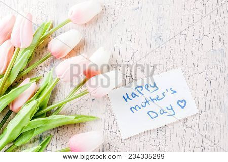 Mother's Day Concept, Greeting Card Background. Flowers Tulips And Greeting Note Happy Mother's Day