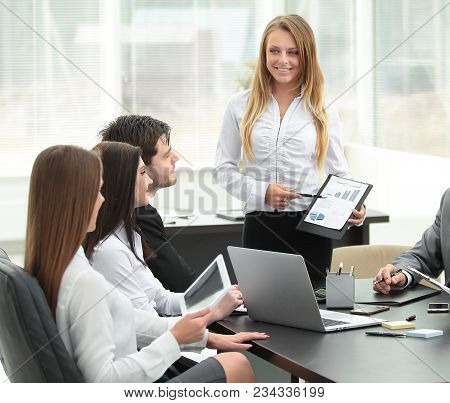 Businesswoman Explaining Business Plan To Her Colleagues.photo With Place For Text