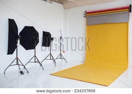 Shot Of Studio With Modern Interior Annd Lightning Equipment. Photo Of Up Do Date Photo Studio Prepa