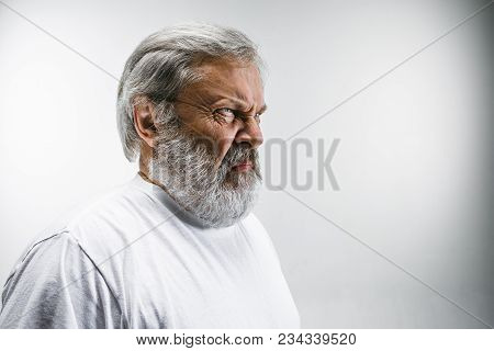 Mature man with disgusted expression repulsing something. Disgust concept. Young emotional man. Human emotions, facial expression concept. Studio. poster